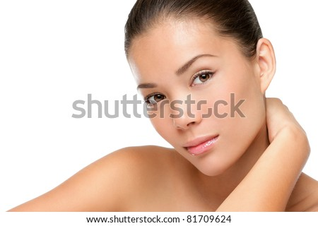 Asian woman beauty face closeup portrait. Beautiful attractive mixed race Chinese Asian / Caucasian female model with perfect skin isolated on white background