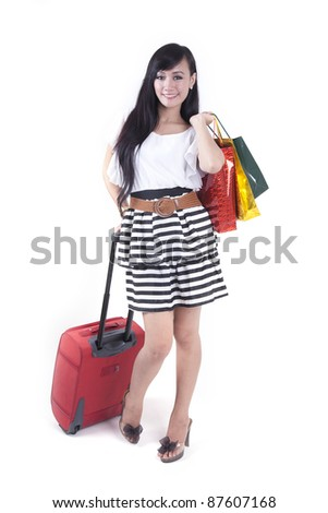 Asian woman brings a suitcase and shopping bags