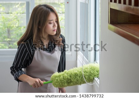 asian woman cleaning windows, doing housework with duster #1438799732