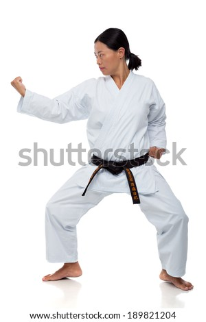 Asian woman demonstrating karate position