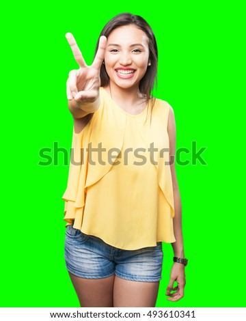 asian woman doing victory gesture stock photo