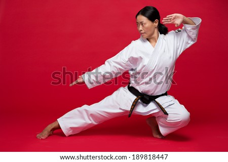 Asian woman exercising karate