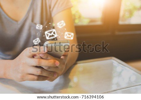 Asian woman hand using mobile phone with e-mail application, Concept email and newsletter