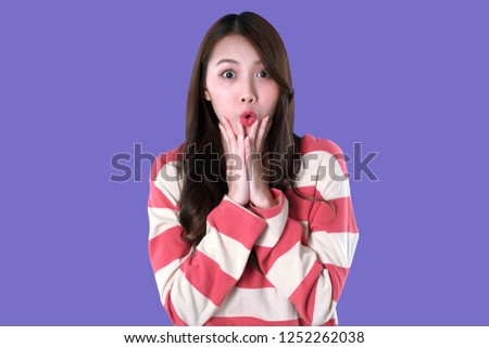 Asian woman happy to get a special deals & discounts promotions, winter clothing, purple background