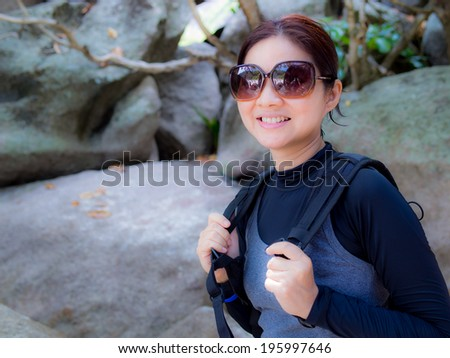 Asian woman hiking in mountain. Recreation and healthy lifestyle outdoors in nature