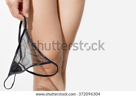 Asian Woman holding black g-string with space for text