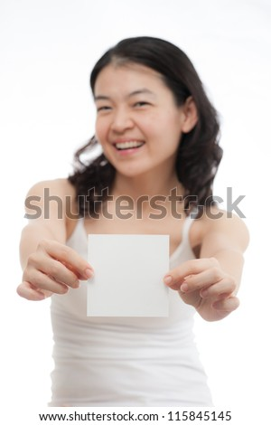 asian woman holding empty white card, focus at card