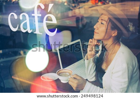 Asian woman in coffee shop with notebook : Art filter vintage color tone style