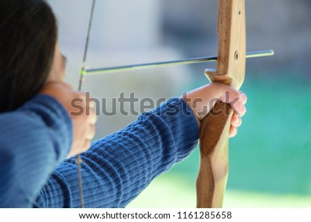 asian woman is  holds her bow...