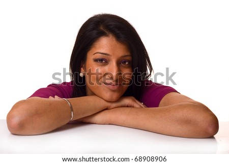 asian woman leaning on a table isolated on a white background.