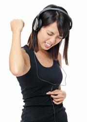 Asian woman listen to rock music