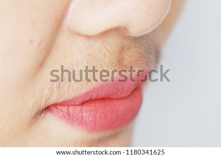 Asian woman mustache.Closeup.