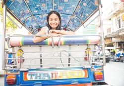 Asian woman on a taxi tuk tuk in Bangkok,Thailand