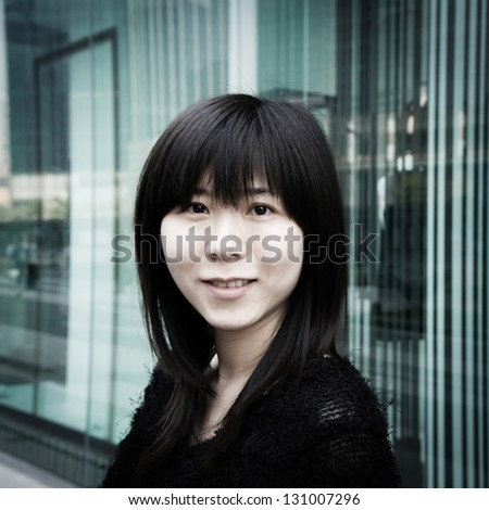 Asian woman portrait at urban shopping centre