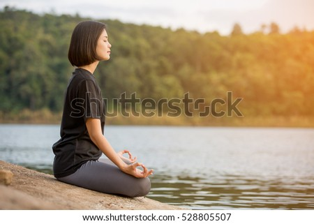 asian woman practicing yoga relax in nature to relax outdoor #528805507