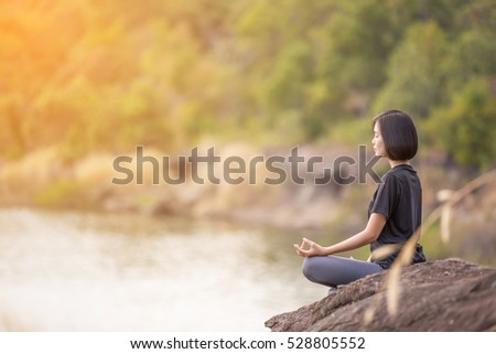asian woman practicing yoga relax in nature to relax outdoor #528805552