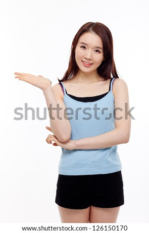 Asian woman present something isolated on white background.