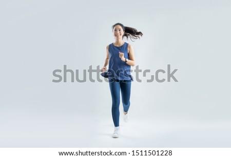 Asian woman run marathon studio white background.
