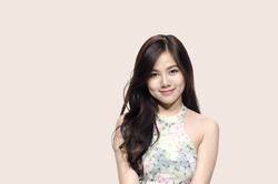 Asian woman smiling with dimple long hair black eyes on pastel pink background cute nice girl face vintage style Beautiful Asian girl with copy space