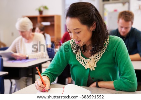 Asian woman studying at an adult education class