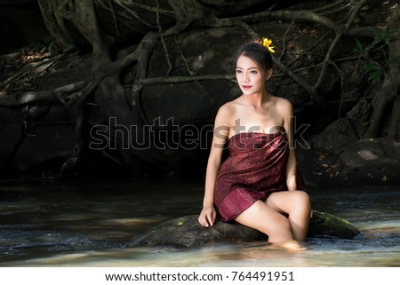 Mad asian women taking a shower