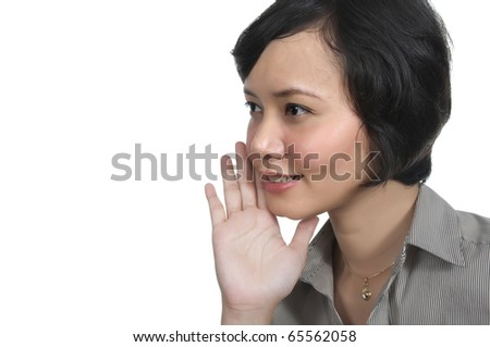 Asian woman tell a secret isolated over white background
