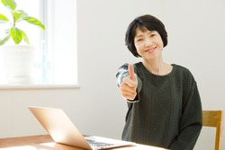 Asian woman thumbs up gesture
