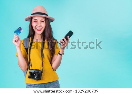 An Asian woman holding passport ready to travel Images and