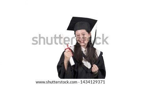 asian woman university graduate student happy excited celebrate victory expressing big success power energy and positive emotion. Celebrates new job joyful. college girl in gown hold diploma on white #1434129371