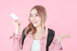 Asian woman use blank credit card for travel with pink background