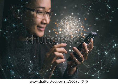 Asian woman using a smartphone with virtual World and connection.Society of Connection Concepts. #1300954345