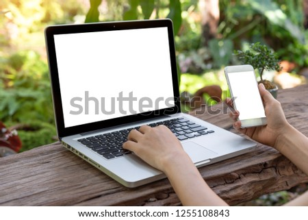 asian woman using laptop and smartphone at outdoor Garden. #1255108843