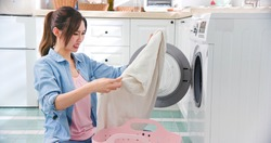 Asian woman wash clothes and feel frustrated at home