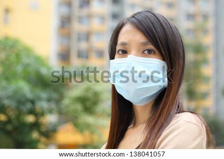 Asian woman wear face mask - stock photo