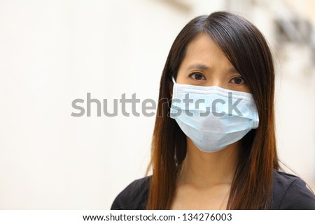 Asian woman wearing face mask