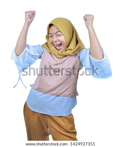 Asian woman wearing hijab happy and excited celebrating victory expressing big success, power, energy and positive emotions. Celebrates for good job isolated over white background #1424927351