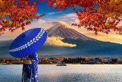 Asian woman wearing japanese traditional kimono at Fuji mountain. Autumn at Kawaguchiko lake in Japan.