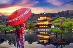 Asian woman wearing japanese traditional kimono at golden pavilion. Kinkakuji Temple in Kyoto, Japan.