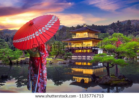 Asian woman wearing japanese traditional kimono at golden pavilion. Kinkakuji Temple in Kyoto, Japan.