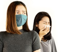 Asian woman wearing mask afraid of friend who having virus infection and coughing
