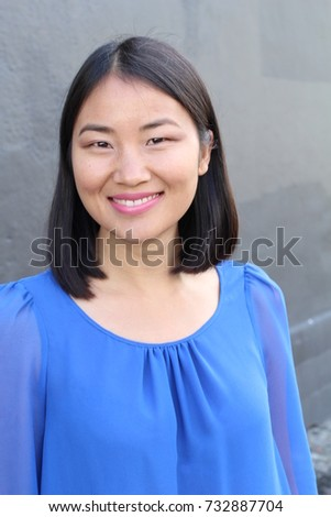 Asian woman with a perfect white smile - Shutterstock ID 732887704