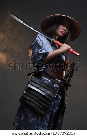 Asian woman with katana and kasa against smokey background Zdjęcia stock ©