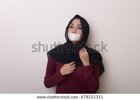Asian woman with taped mouth show deference expression face #678215311