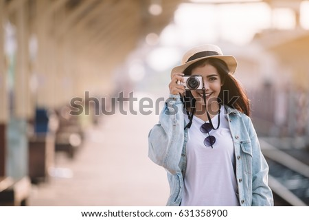 Asian women be smile with camera Travel Holiday Relaxation Concept , Vintage Style.