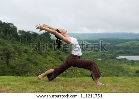 Asian women do Yoga with mountain view, High Lunge
