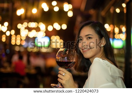 Asian women Enjoying Dinner at Home,Enjoy Concept,Woman drink wine in a nightclub or bar. #1220424073