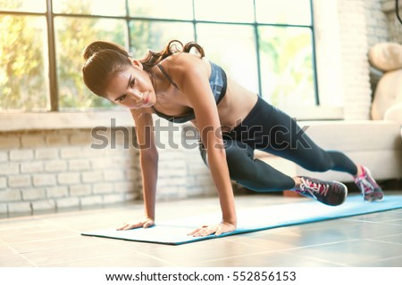 Asian women exercise indoor at home she is acted