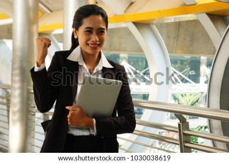 Asian women glad to get new job, good news after job interview. Dress appropriately for work. Happy to be selected to work successfully. Great opportunity, have a future to work. Good job.