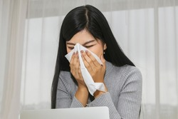 Asian women have chronic sinusitis. seasonal allergies, cold or flu illness A runny nose can make you feel unhealthy by holding a handkerchief and constantly blotting out runny nose  : Concept allergy
