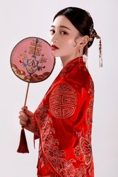 Asian women in ancient red with fans and white background